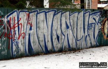 Graff On Wood Plank Fence