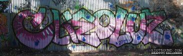Graffiti On Corrugated Fence