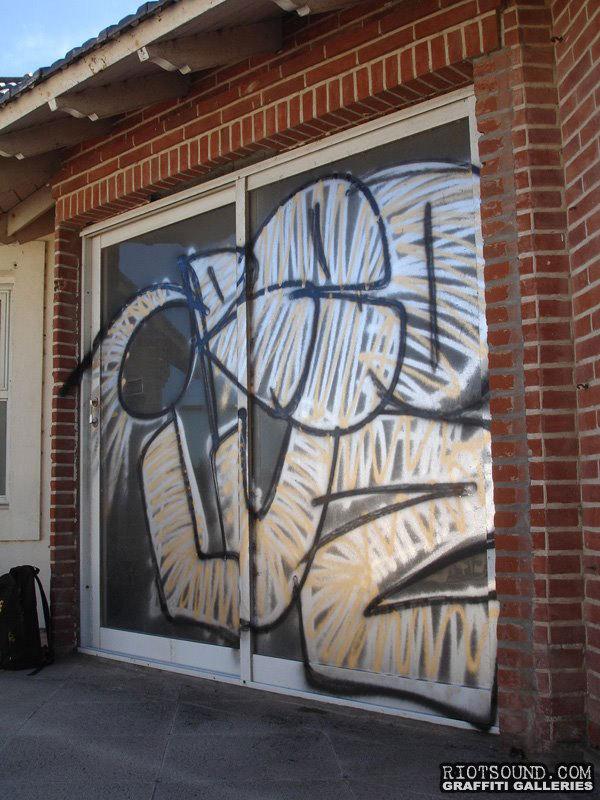 Graffiti On Glass Door